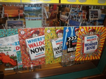 A collection of Where's Waldo books in a storefront window. These make great childrens' gifts.