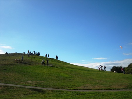 Families and friends gather at the top of Gasworks kite-flying hill