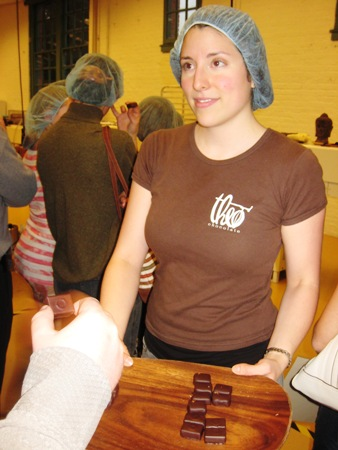 Here Nicole is passing out taste-test confections filled with spearmint-flavored chocolate cream.